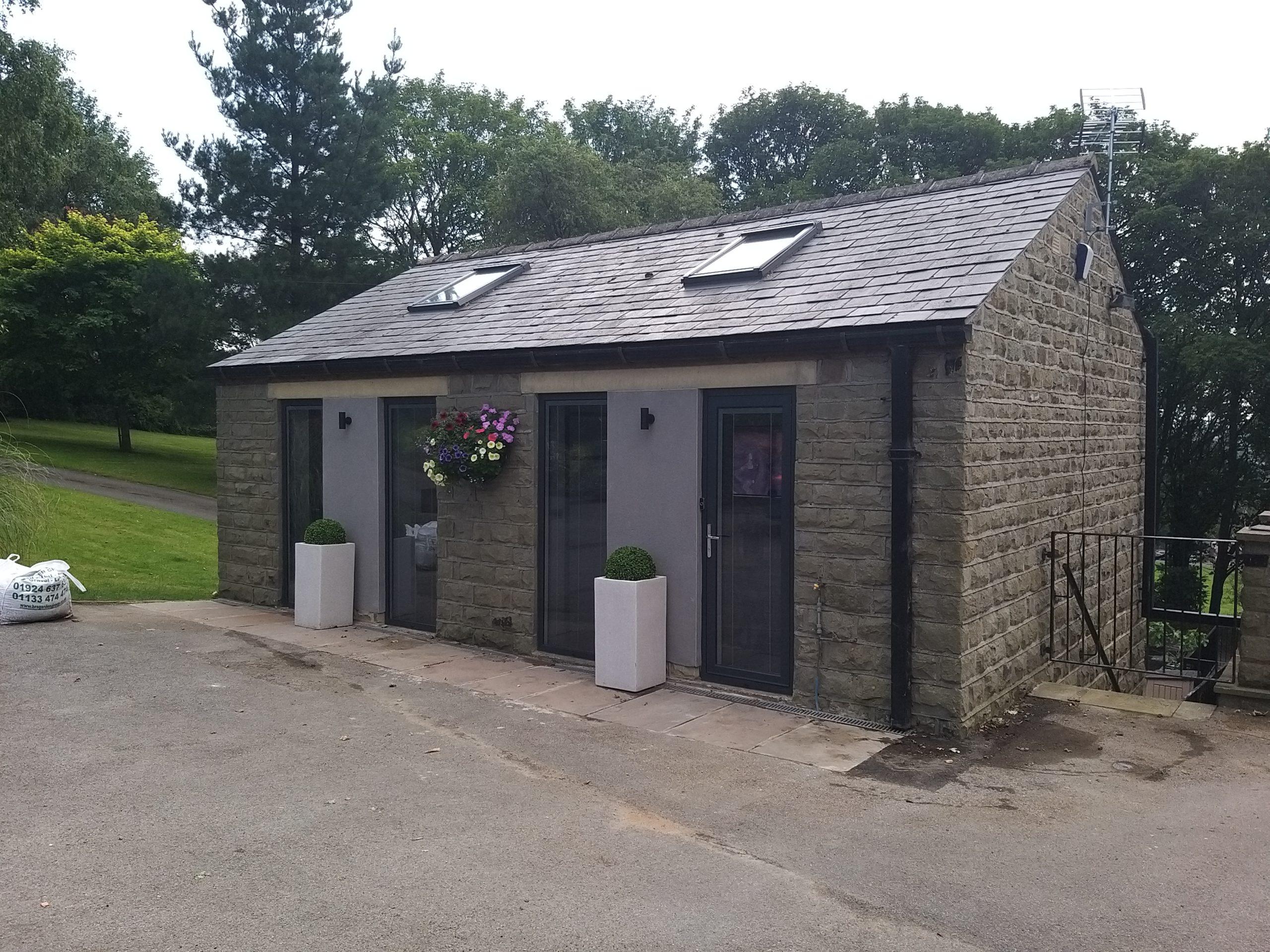view of garage conversion main upstairs door