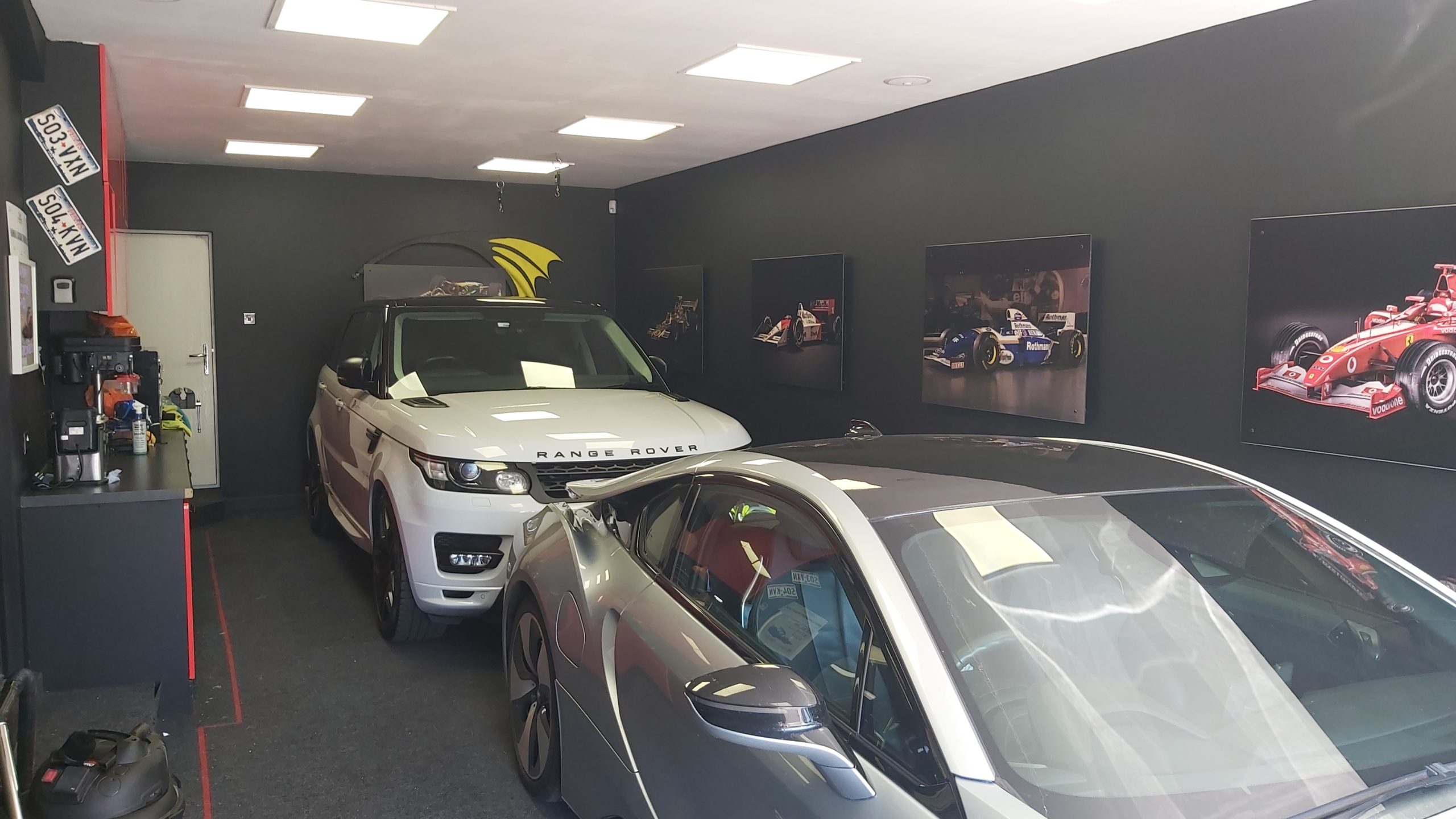 Range Rover and BMW parked in new garage