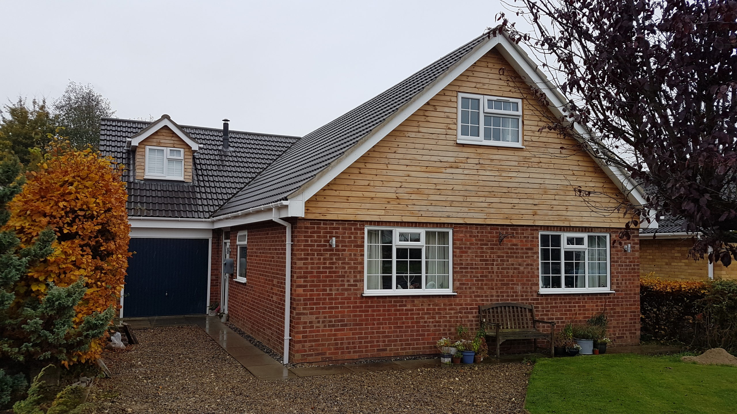 driveway view of bungalow with roof lift