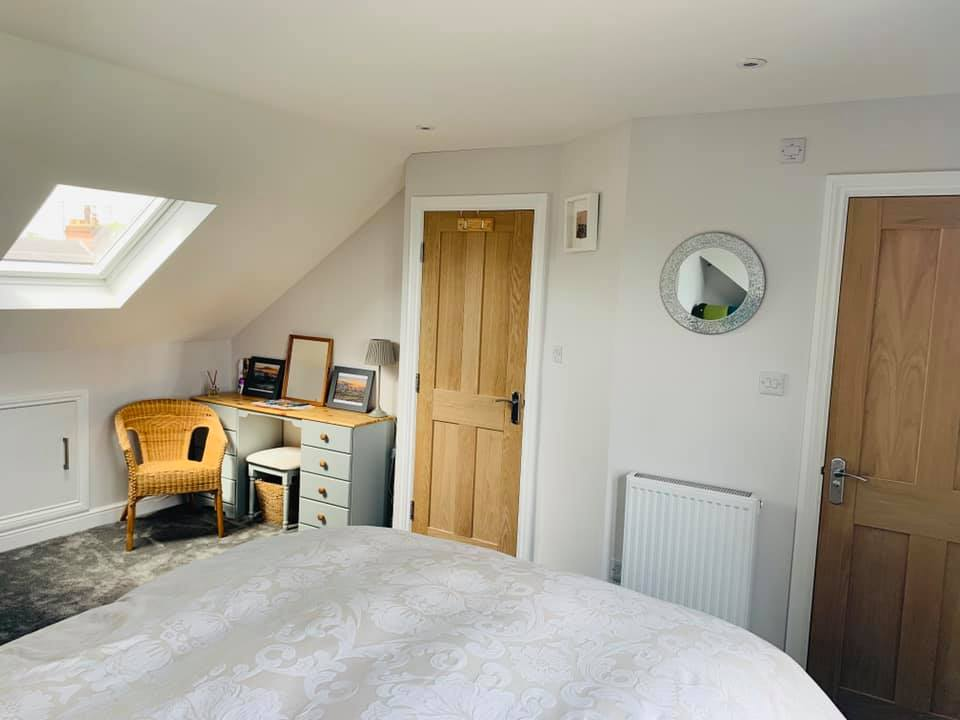 wide angle view of loft conversion with skylight
