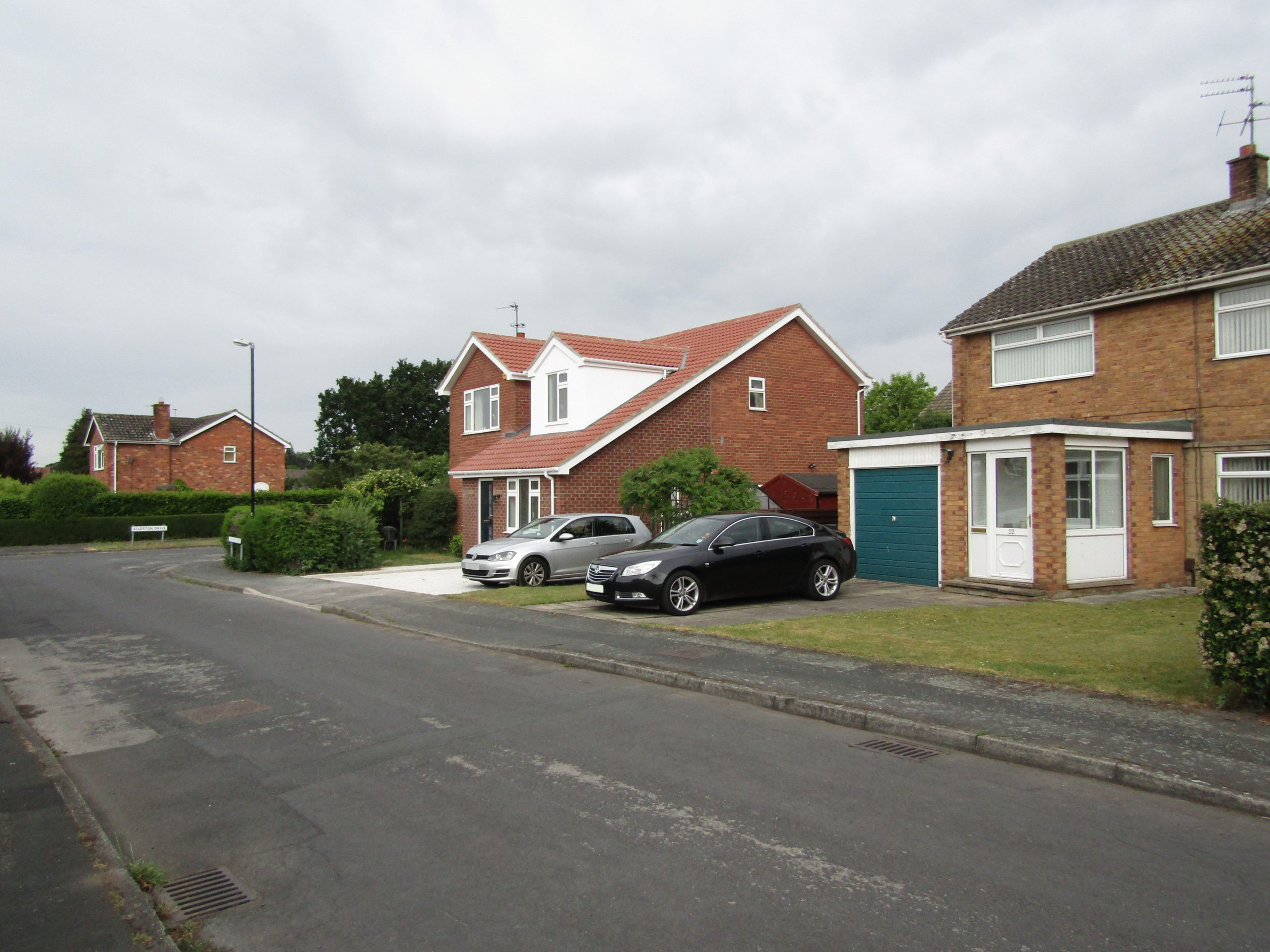 Distant street view of single storey extension and loft conversion