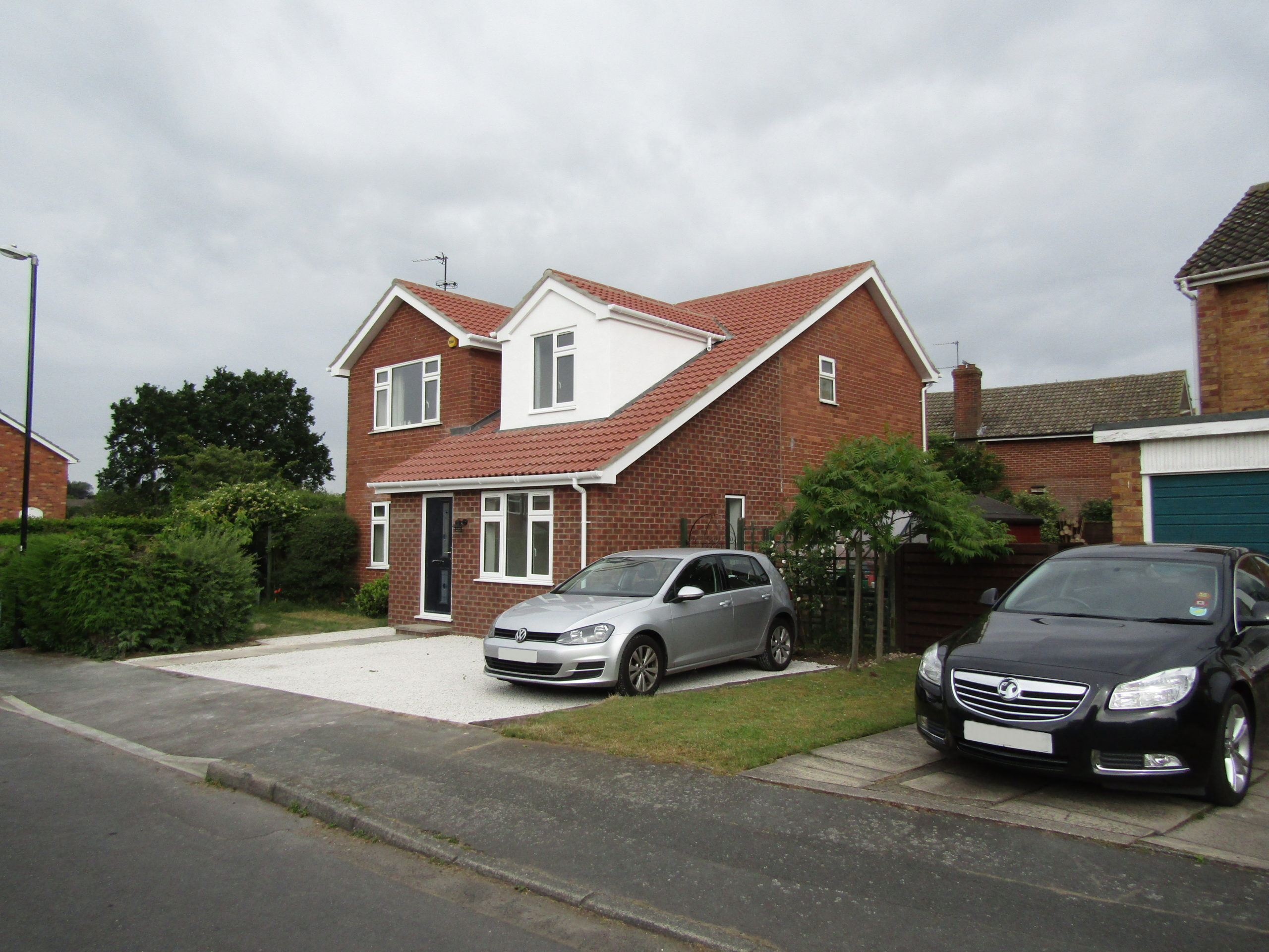 Second front of house view of loft conversion and extension