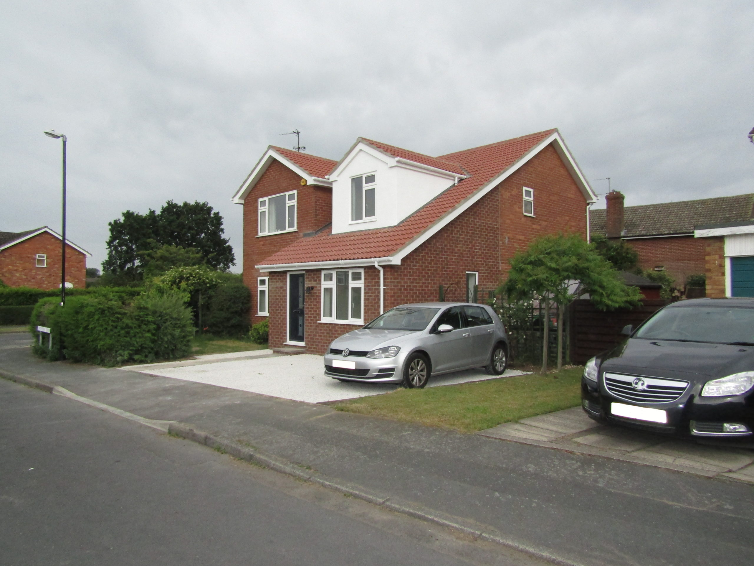 Front of house view of dormer loft conversion and extension