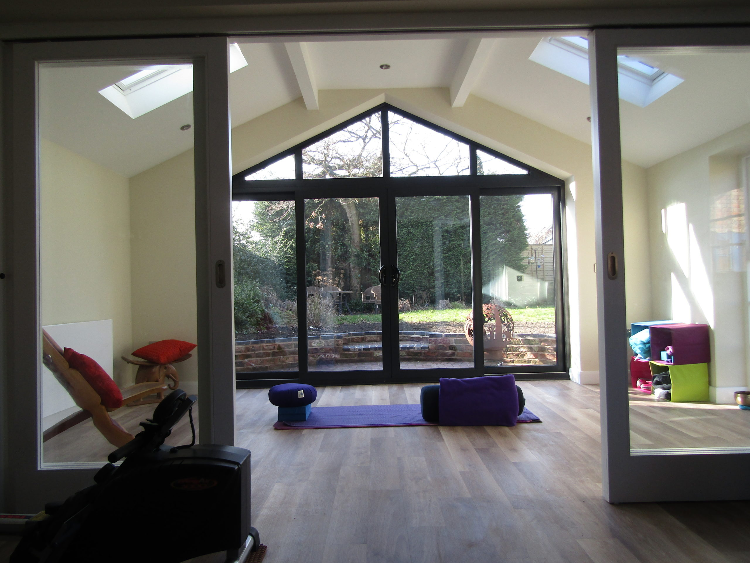 Spacious fitness centred garage conversion room.