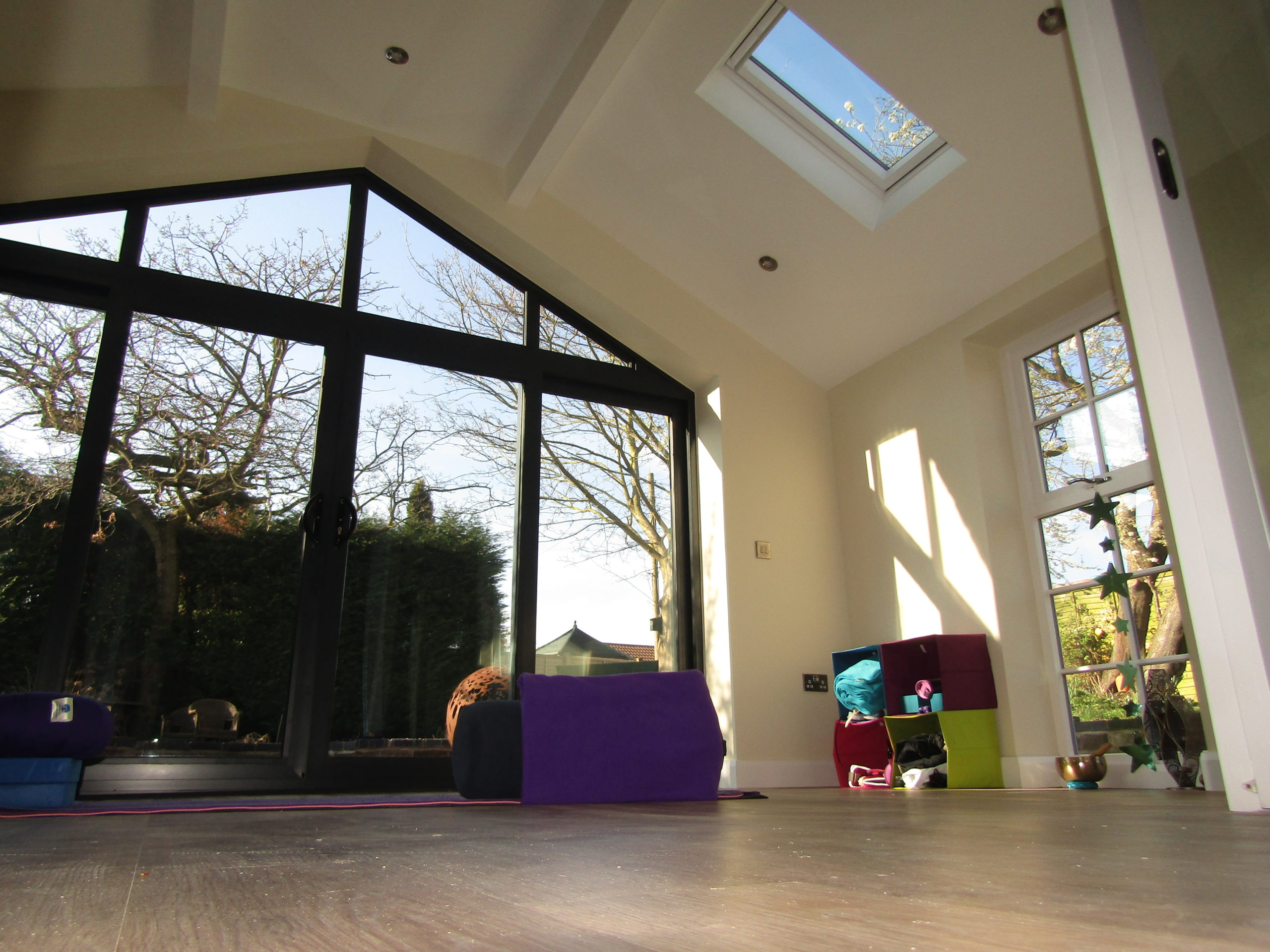 ceiling view of garage conversion with skylight