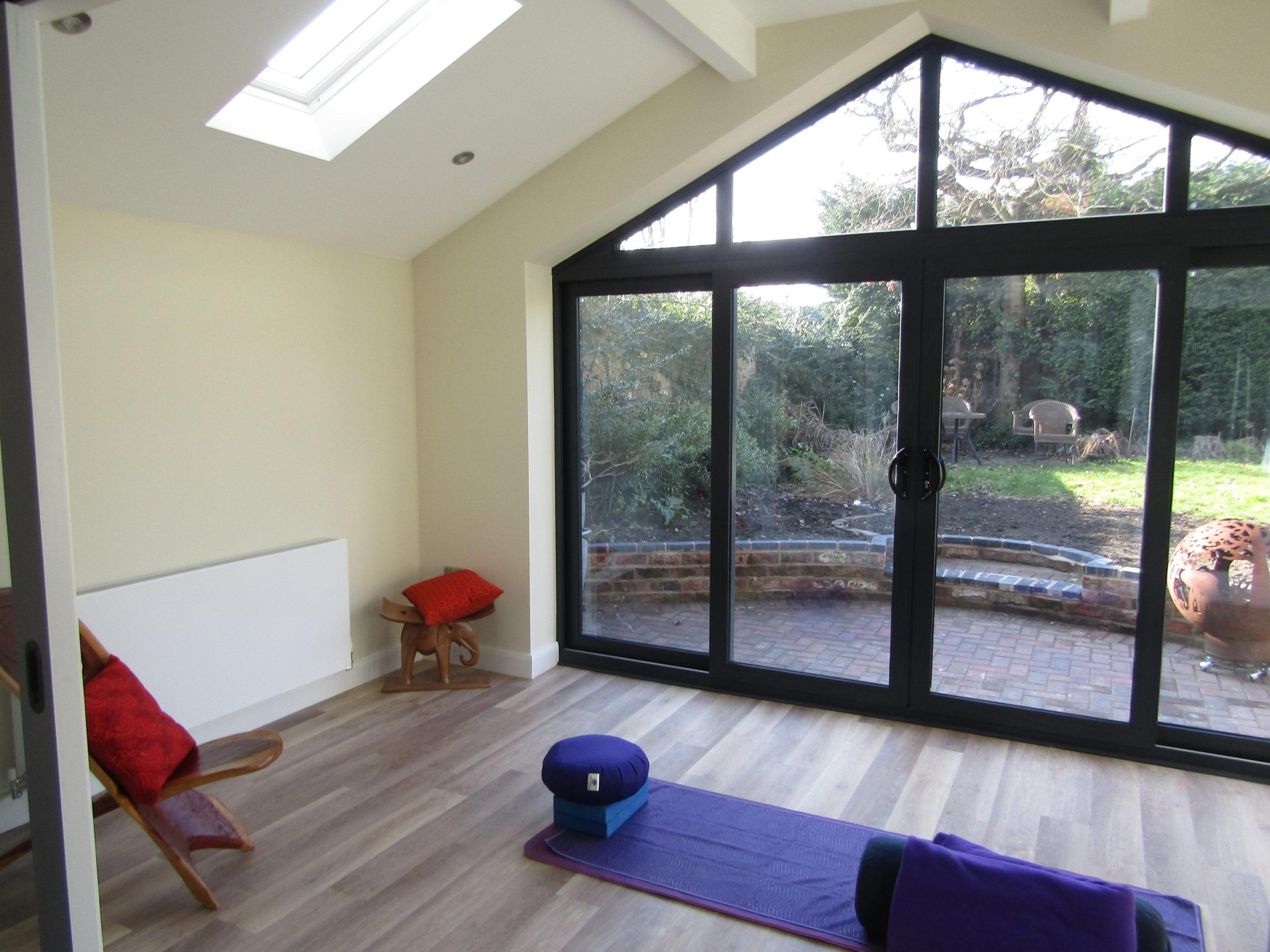 Yoga mat and block inside garage conversion