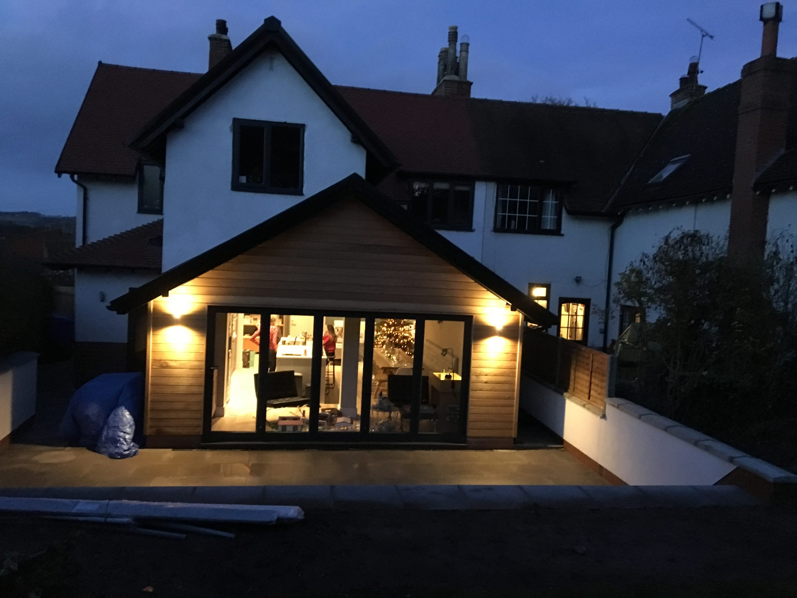 Outside view of rear house extension with lights