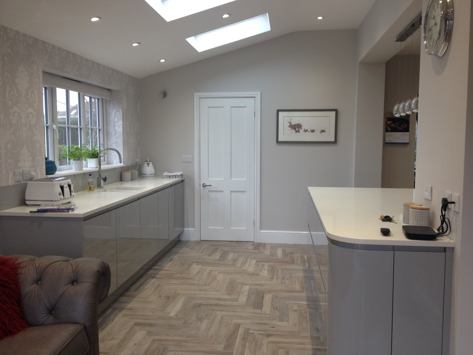 Modern grey kitchen in wrap extension