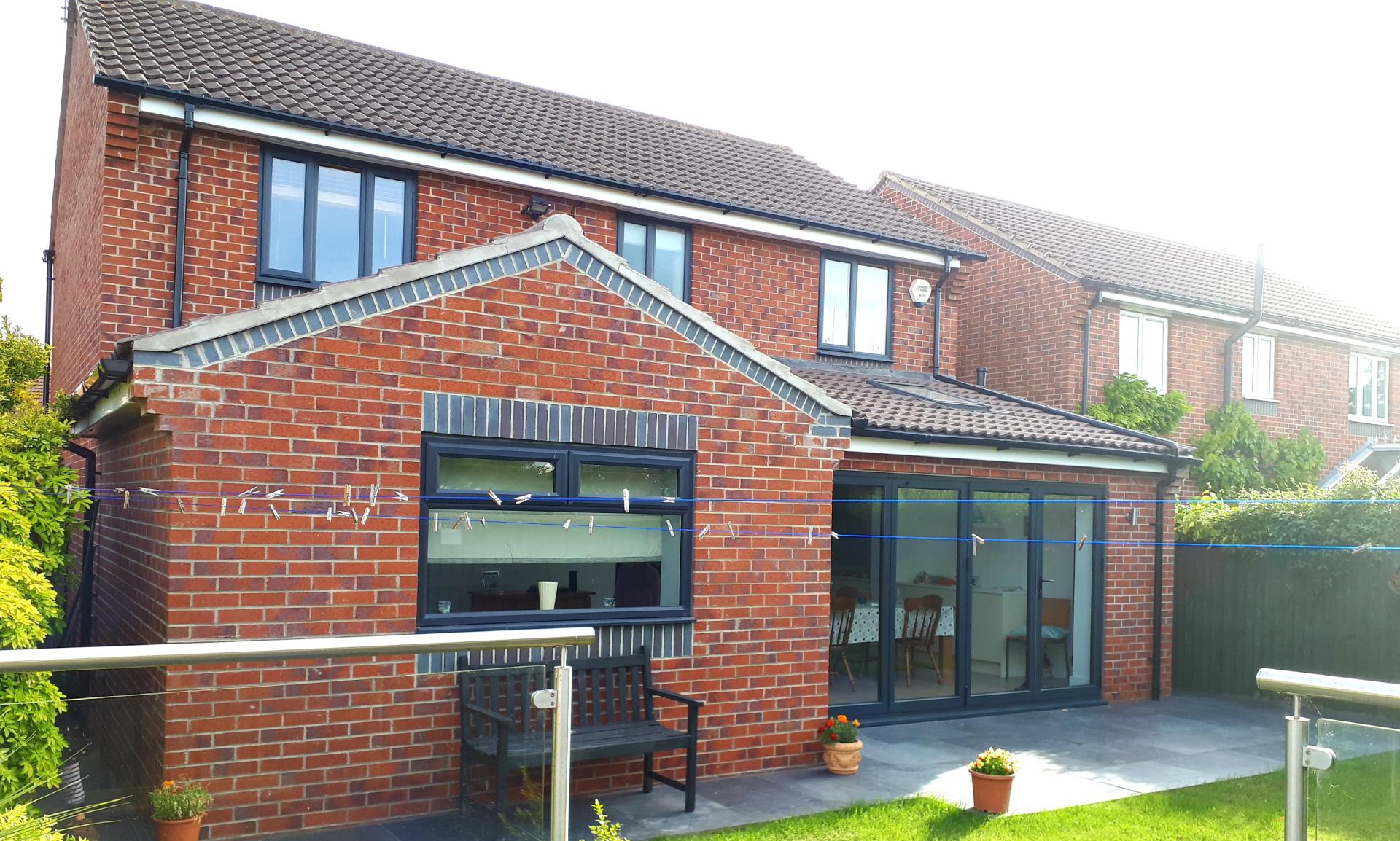 Garden view of single storey extension with bifold doors