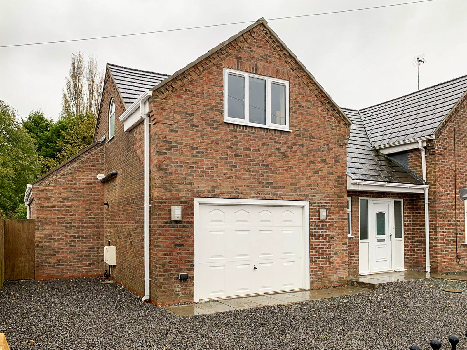 Garage and side view of double storey extension