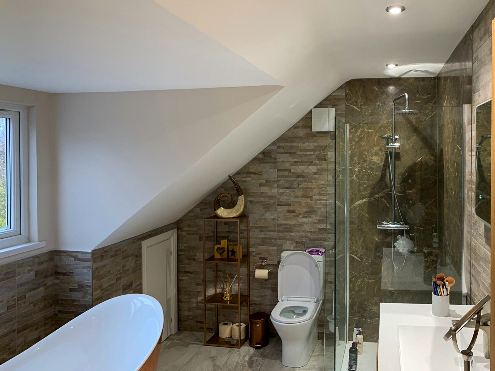 bathroom and sloping ceiling in bathroom of double extension