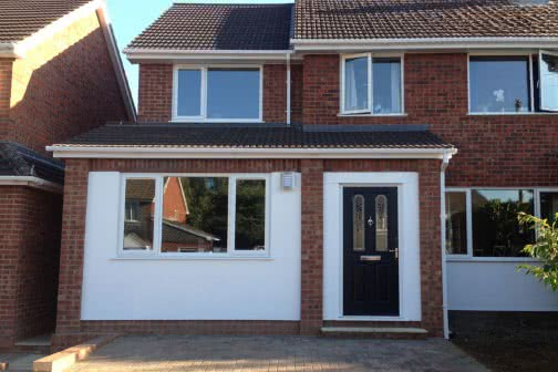 Double storey extension with white features