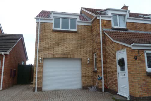 Double storey extension with garage on ground floor