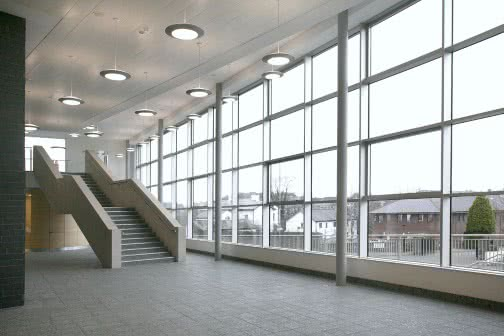 staircase next to huge glass wall inside an education building