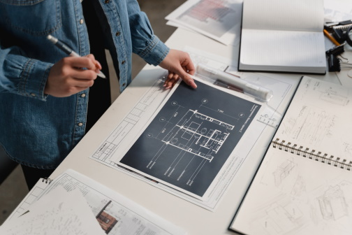 Person working on architectural plans